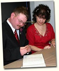 Glenn and Janet signing the register