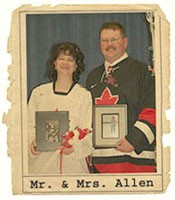 Janet and Glenn holding photos of their deceased father and mother